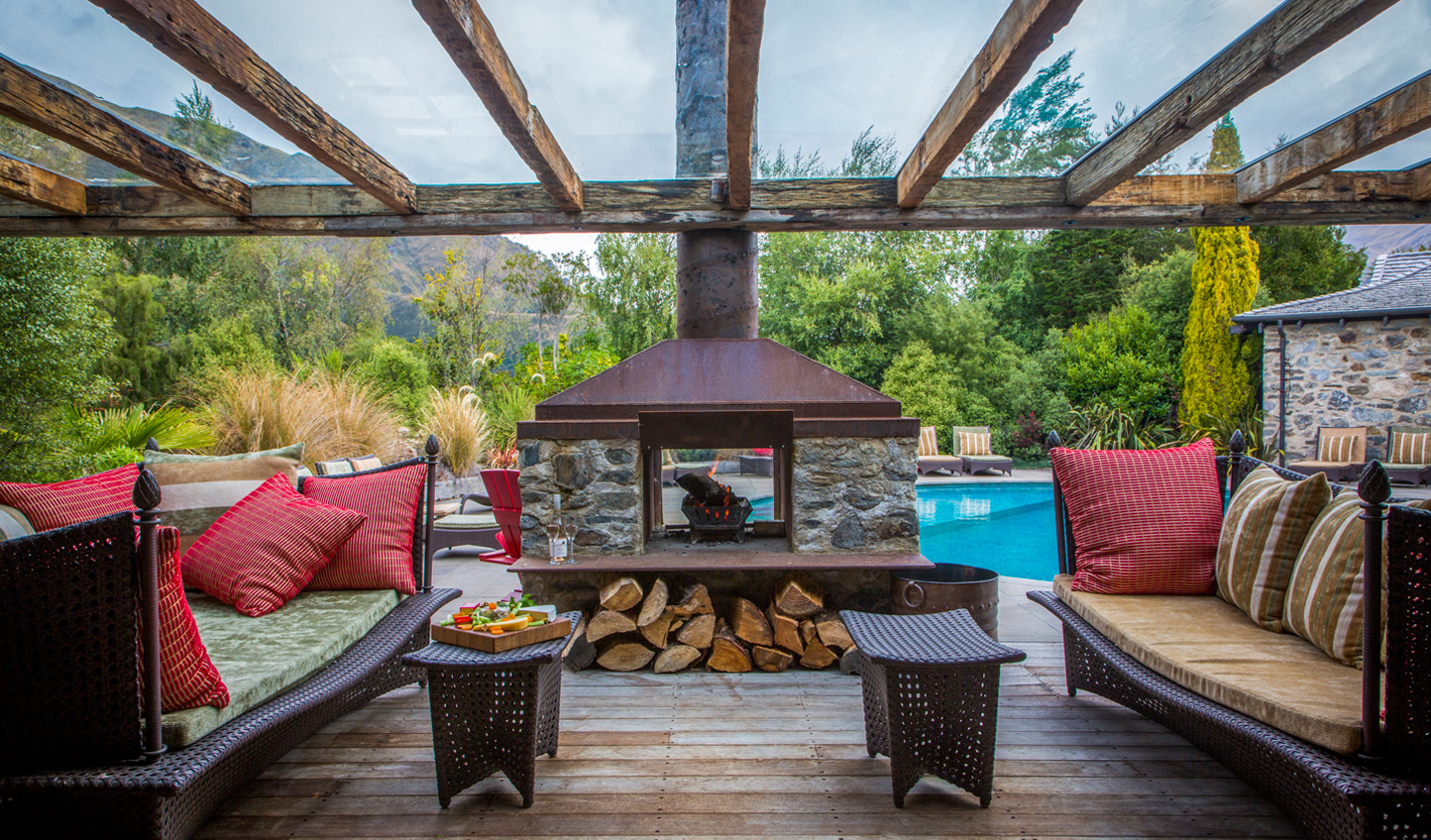 Venture outside and sit poolside by the log-burning fire