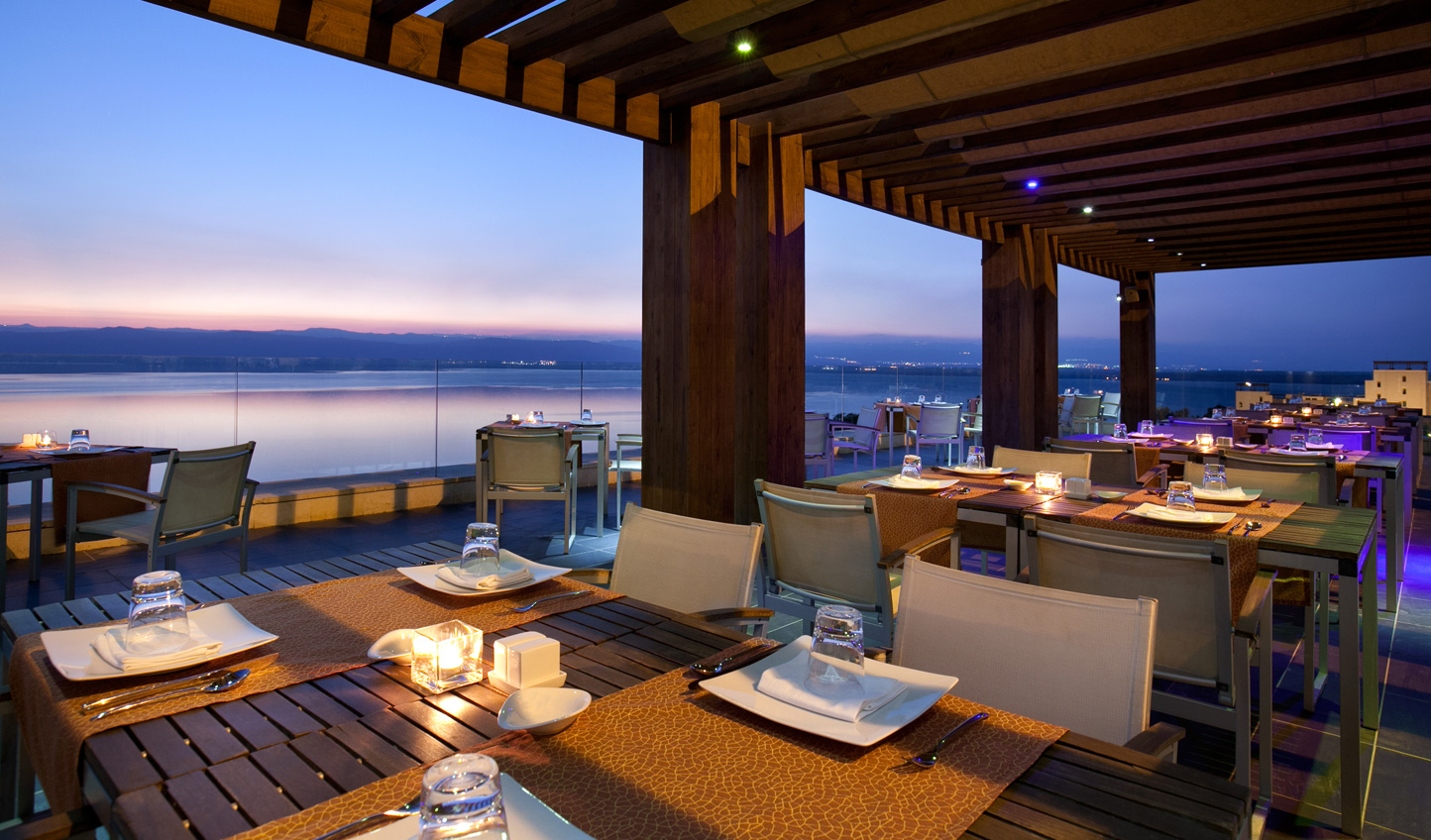 Enjoy dinner at Codes Thai restaurant and watch the sun sink into the sea