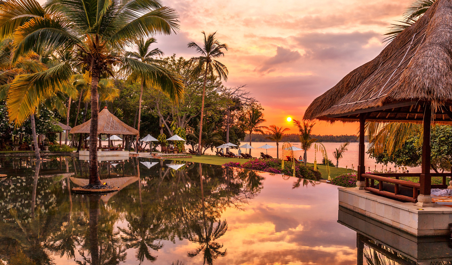 Watch the sun dip down over the infinity pool