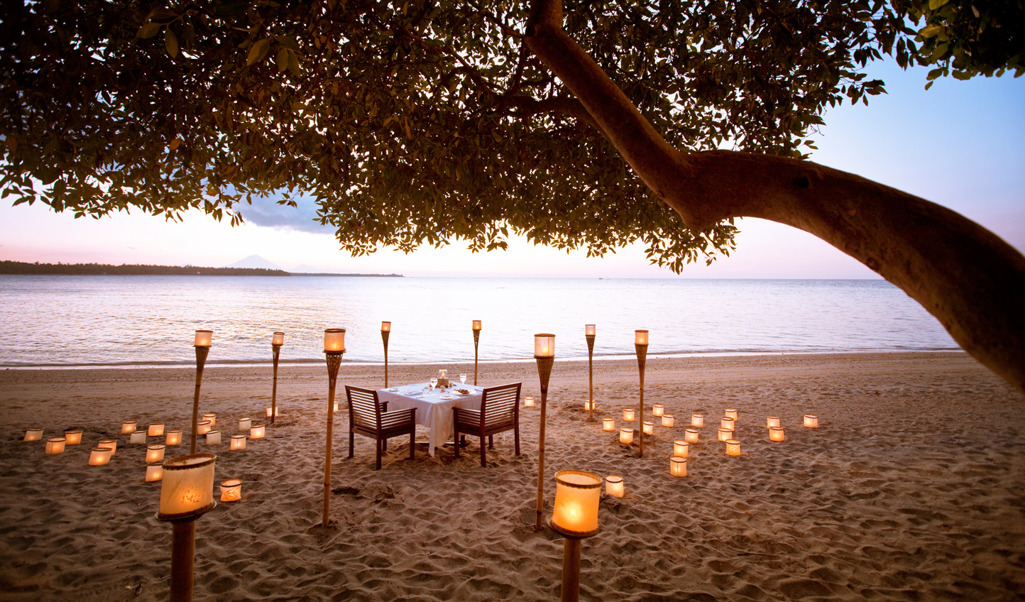 Find a quiet corner of the beach for a romantic dinner for two