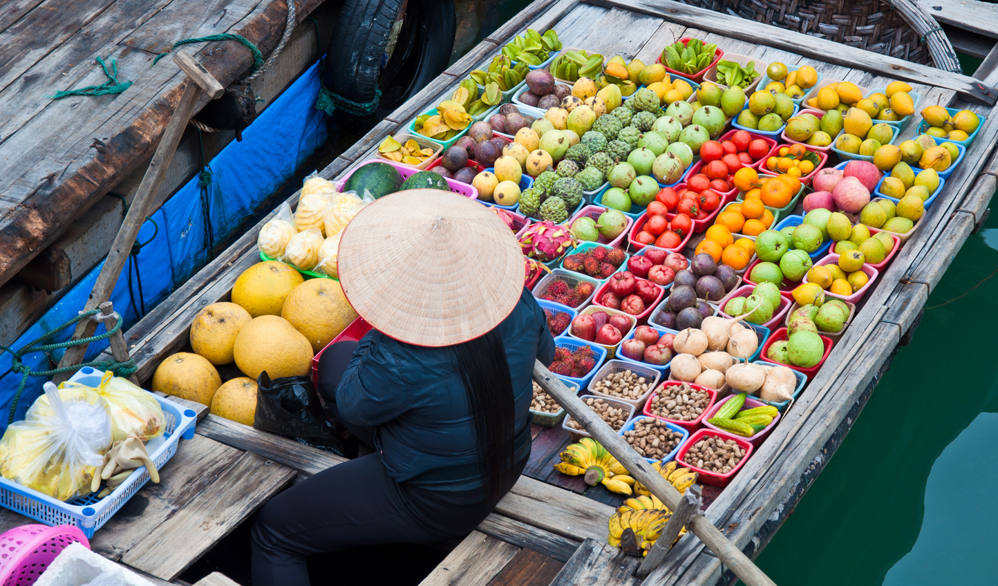 Visit a floating market and pick up fresh produce