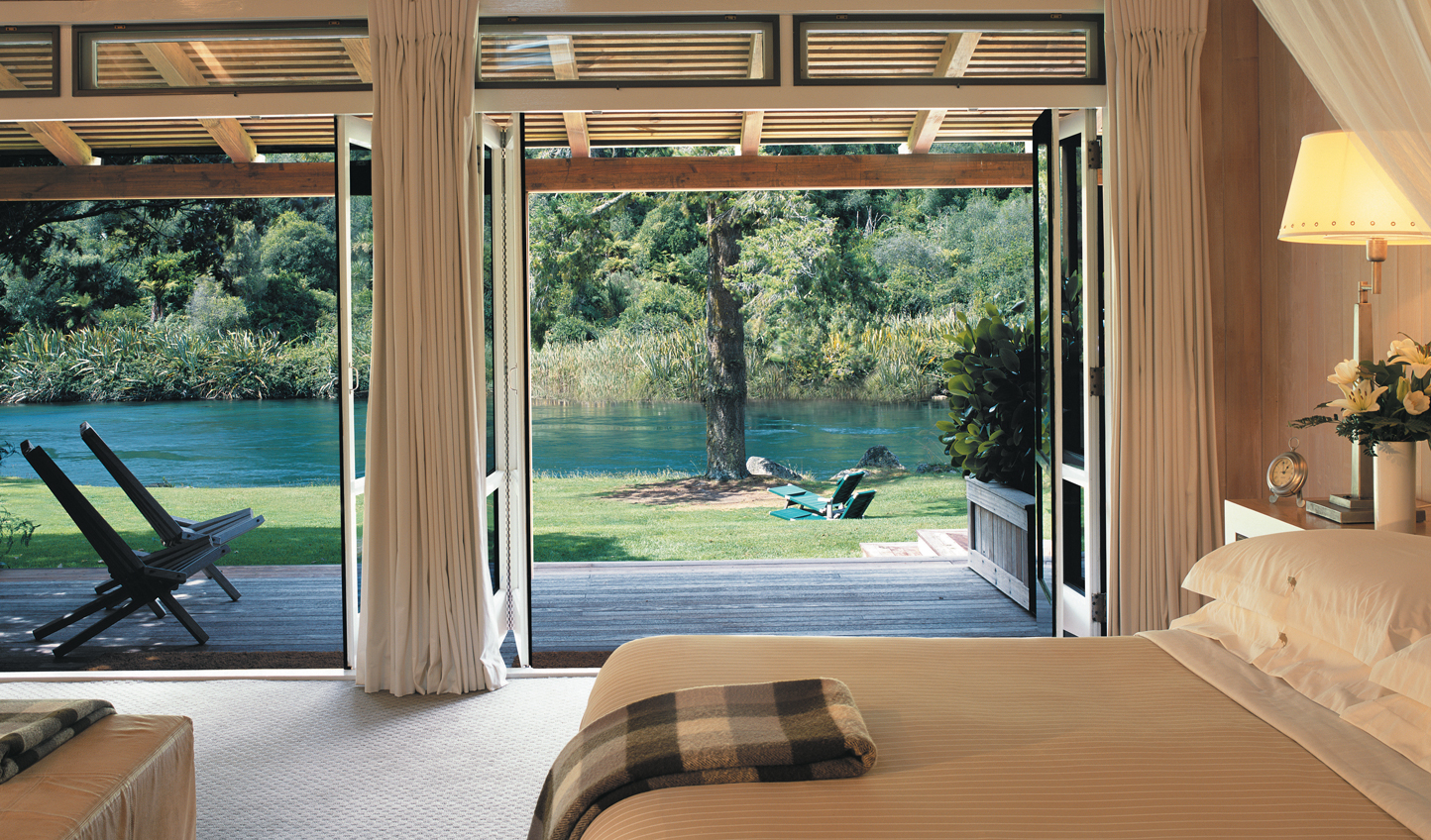 Stroll straight out of your suite onto the manicured lawns of Huka Lodge