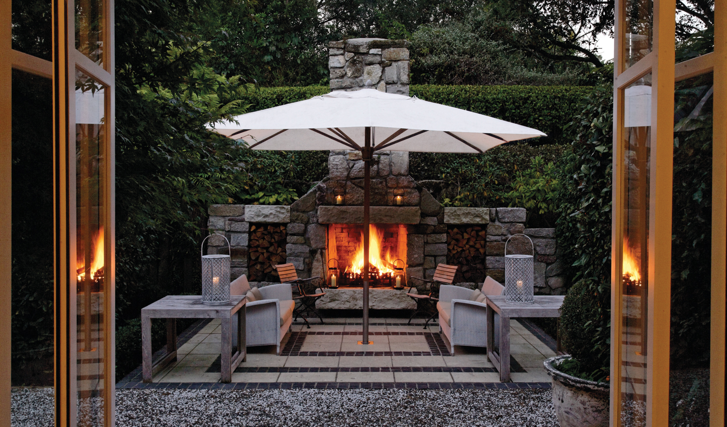 Spend summer evenings by the outdoor fireplace