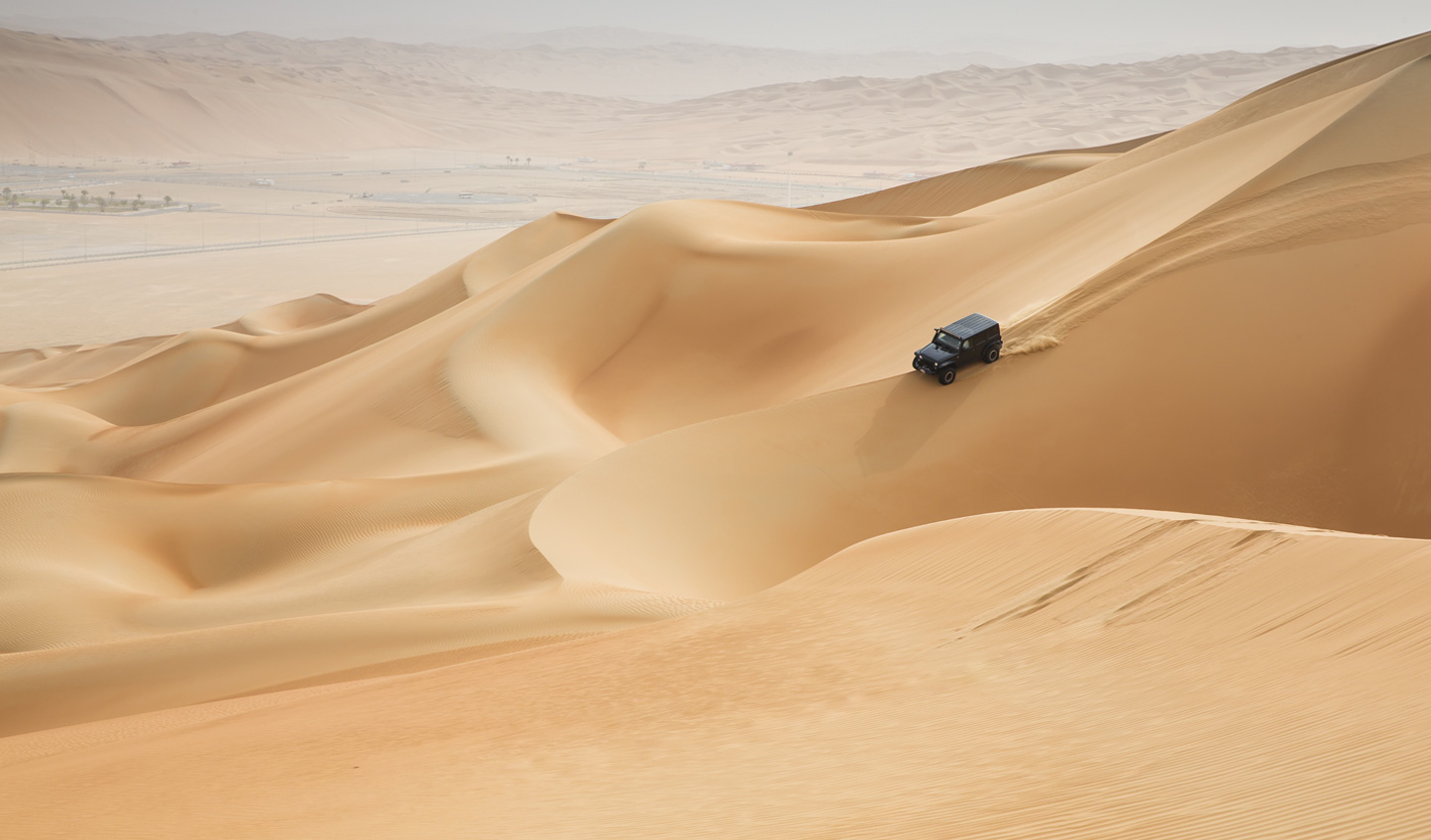 Get behind the wheel and bash across the dunes
