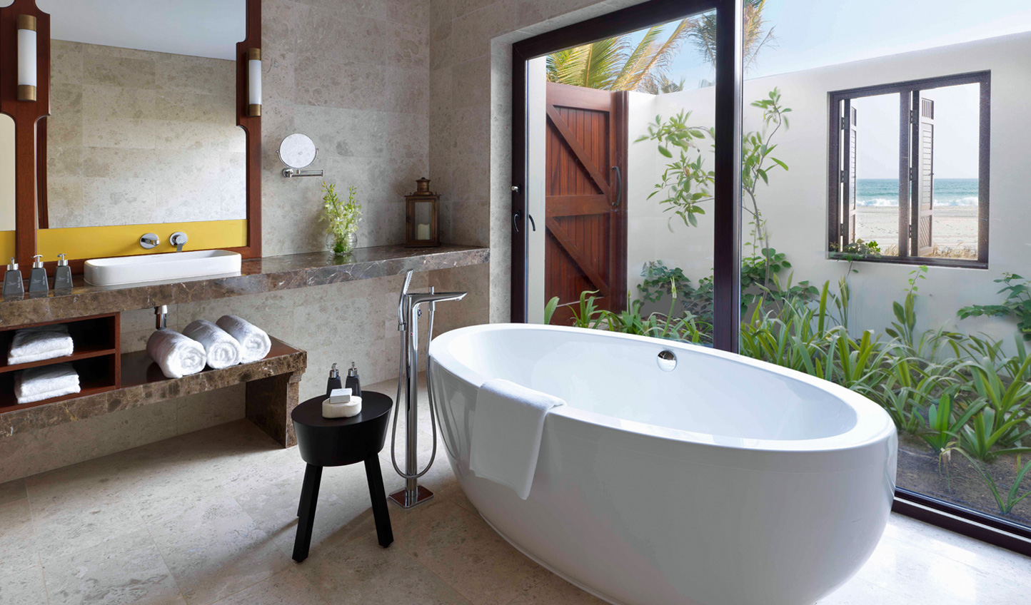 Bathe beneath the bubbles in your Royal Beach Villa