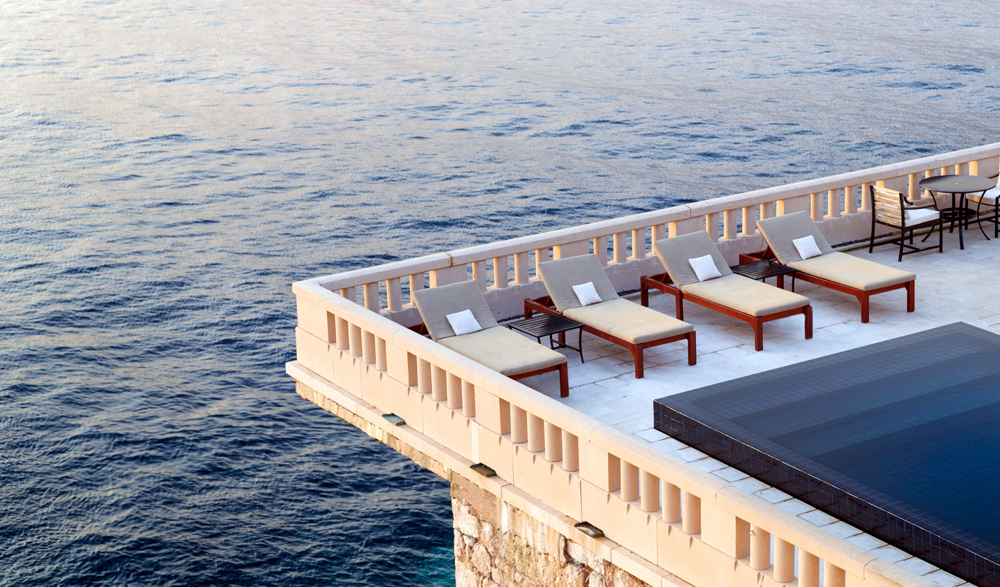 Relax by the pool and admire the views out to sea