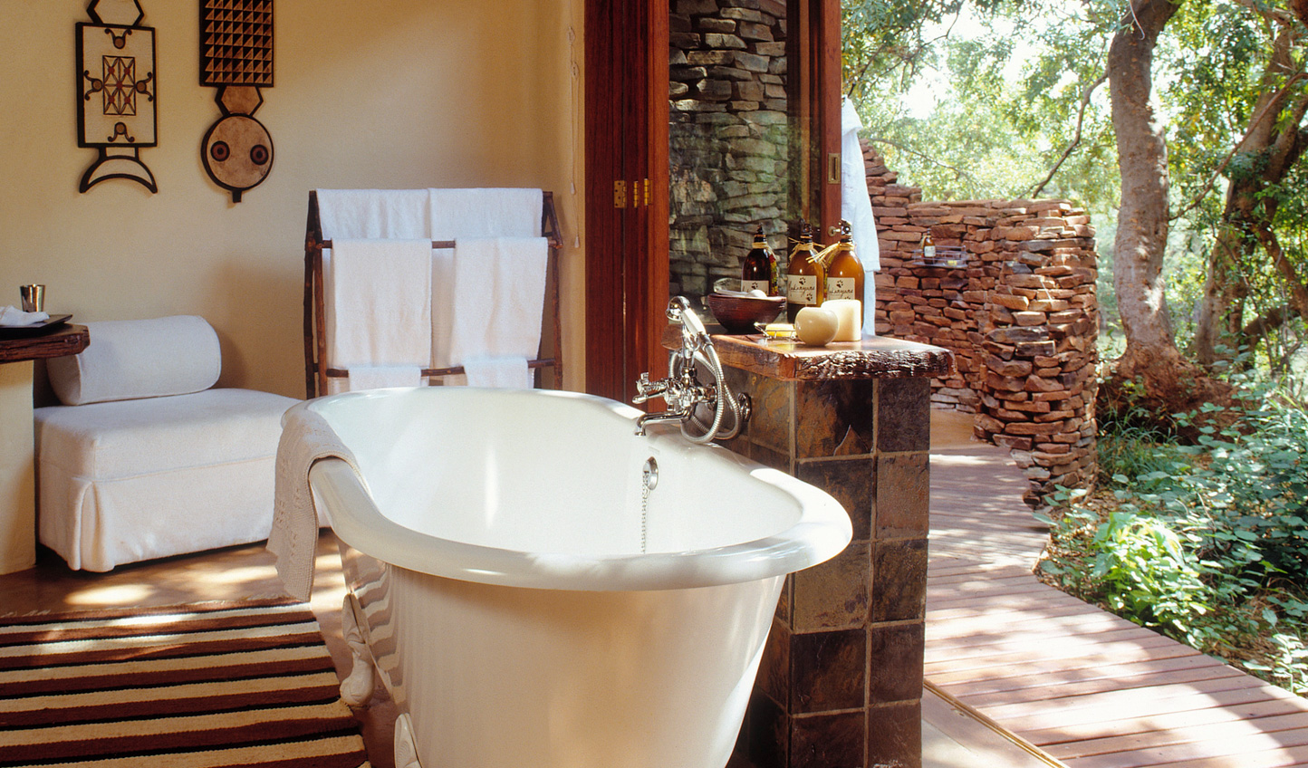 Slip into the tub and soak in your surroundings in the open bathrooms