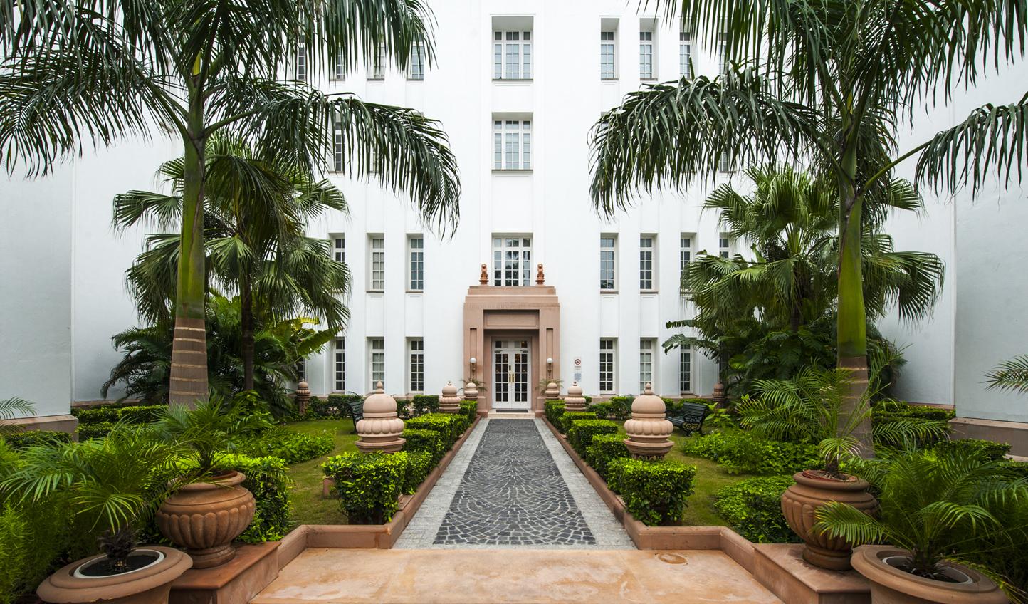 Stroll along palm-fringed walkways