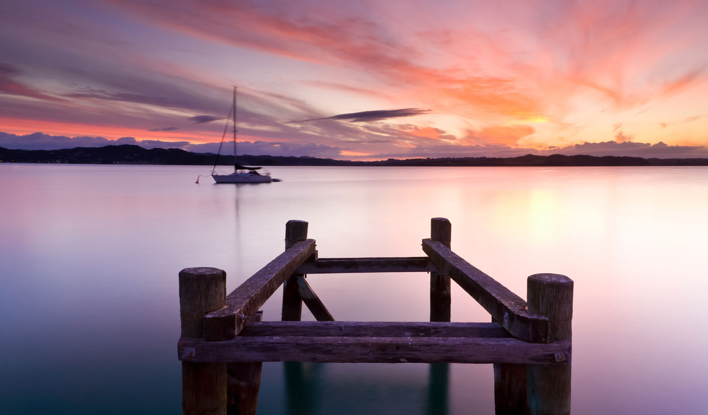 Sail into the sunset around the Bay of Islands