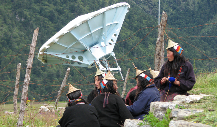 image of the local laya people wearing conical hats