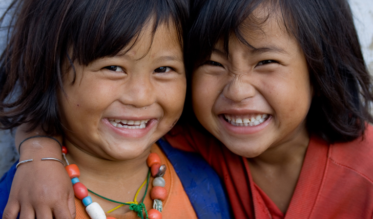 image of two bhutanese children smiling