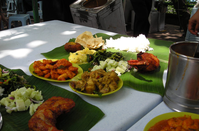 sit down to a delicious feast served on a banana leaf