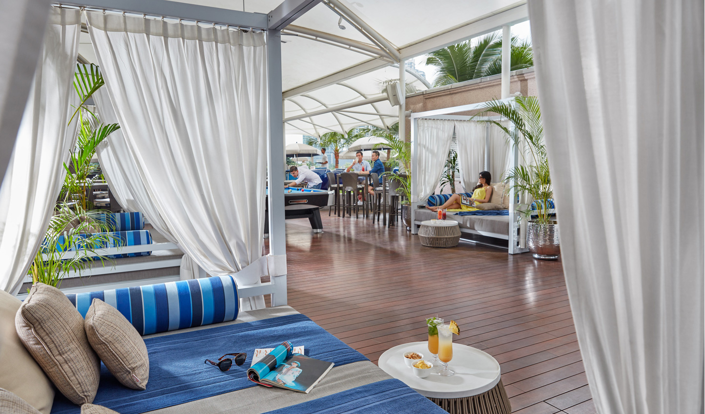 Relax in the day beds by the pool