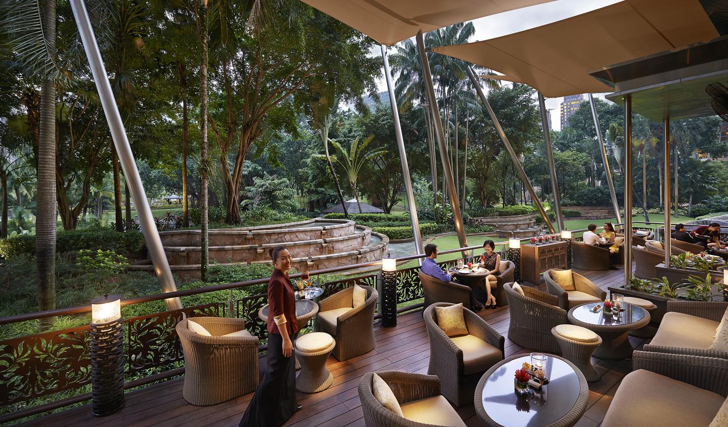 Dine al fresco amid tropical gardens