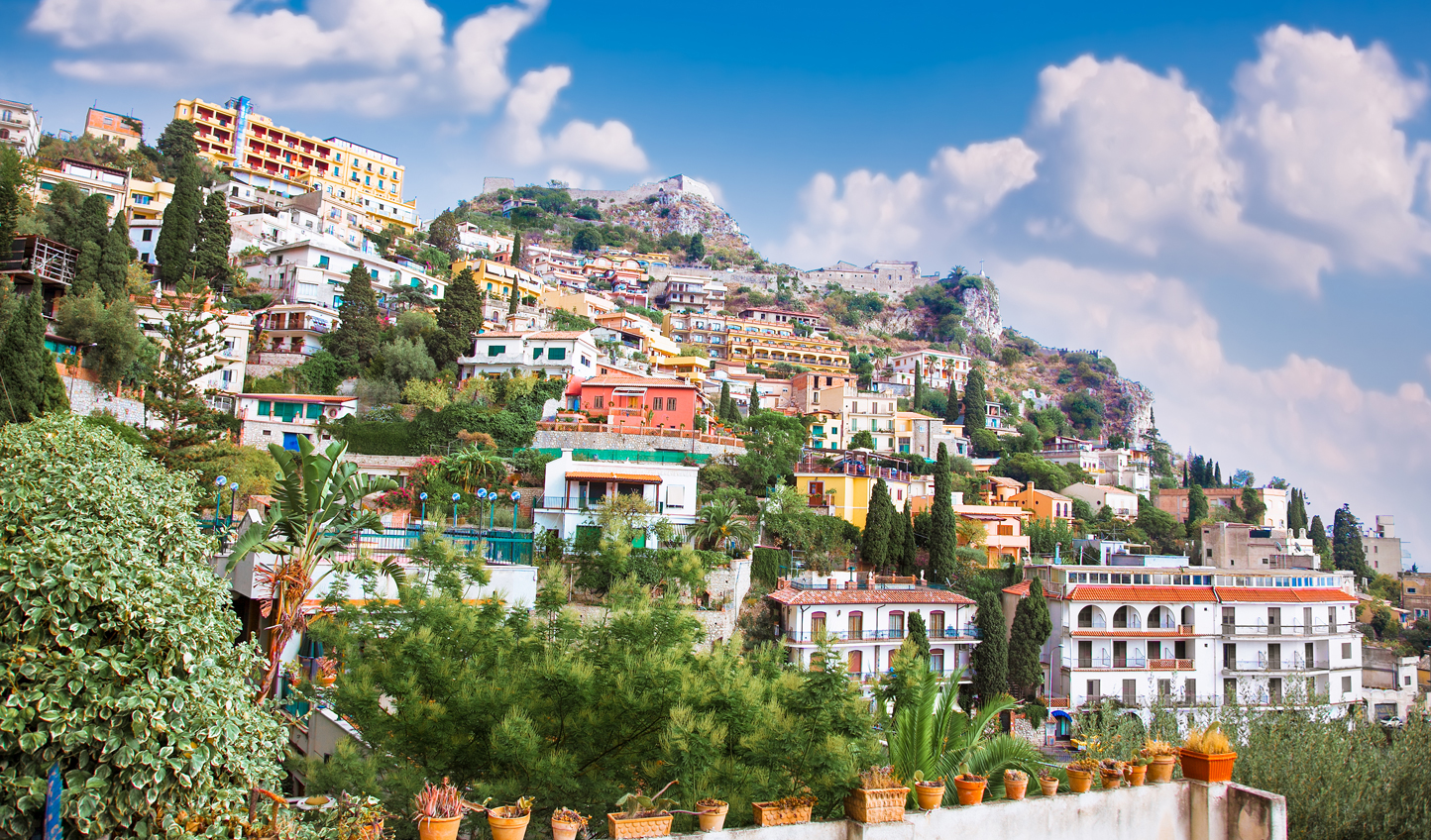 Arrive into the beautiful clifftop town of Taormina