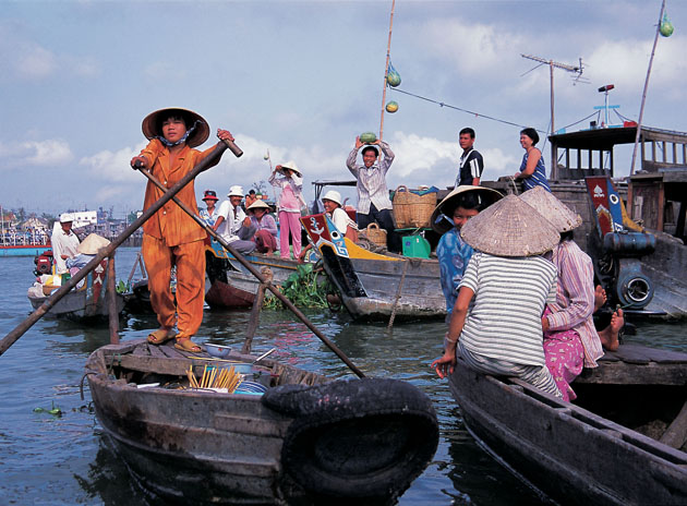 view of the vietnamese paddling along the river