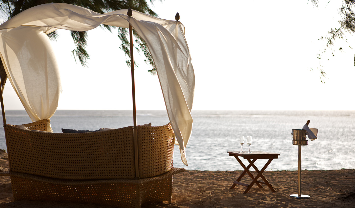 Find a quiet spot on the beach to end the day with a sundowner