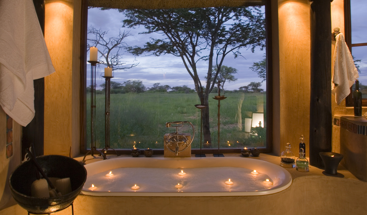 Sink into a candlelit tub and look out over the plains