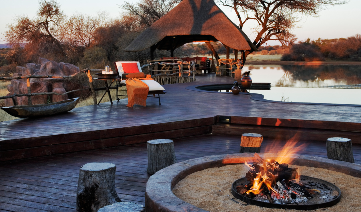 Gather round the campfire at Okonjima Villa