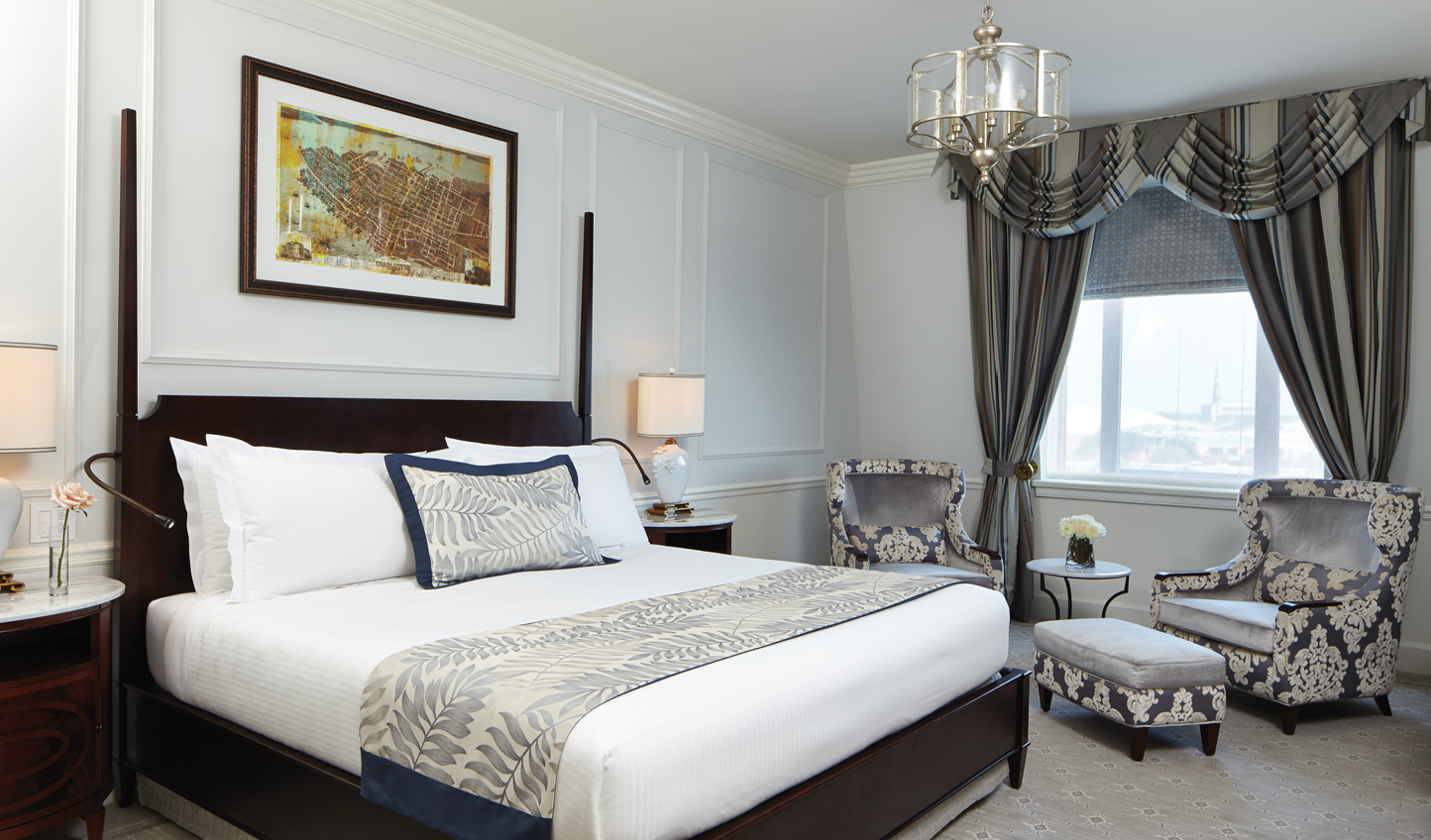 Luxurious guestrooms with neutral colours and crisp linens