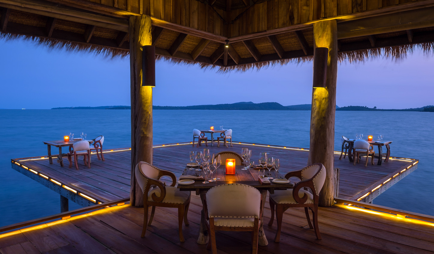 Dine by candlelight amid the warm ocean breeze