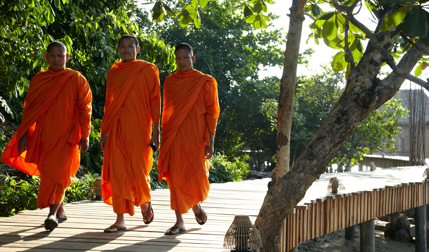 Pay your respects and offer up alms to the local monks