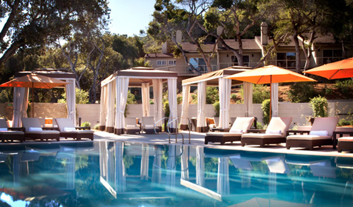 The sun-kissed pool and sun loungers at Carmel Valley Ranch, California, USA