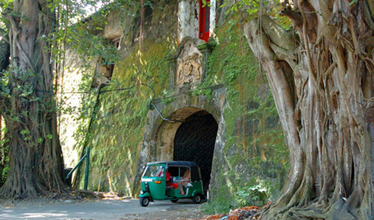 A vine-covered entrance way leading into the Galle Fort Hotel, Sri Lanka