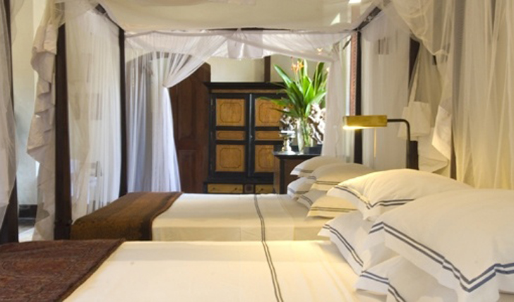 a canopied, four-poster bed at Galle Fort Hotel, Sri Lanka