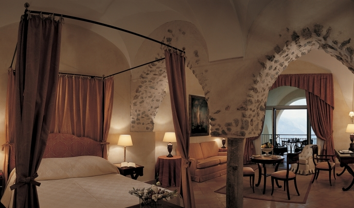 A luxurious suite with archways at Hotel Caruso, Italy