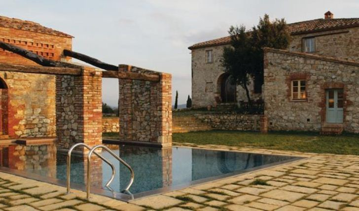 sun-kissed pool and patio, Castello Di Casole, Italy