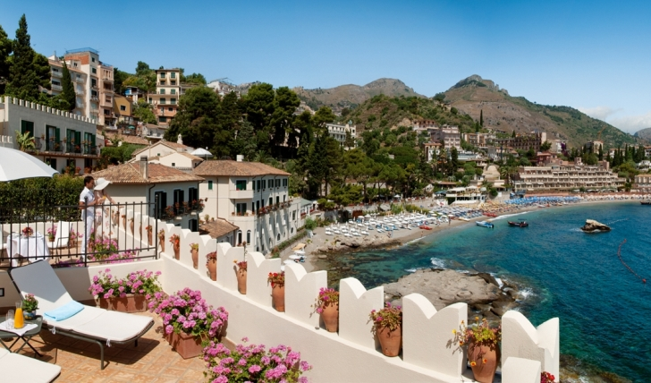 A lovely private sun-terrace overlooking the sea at Villa Sant' Andrea, Sicily