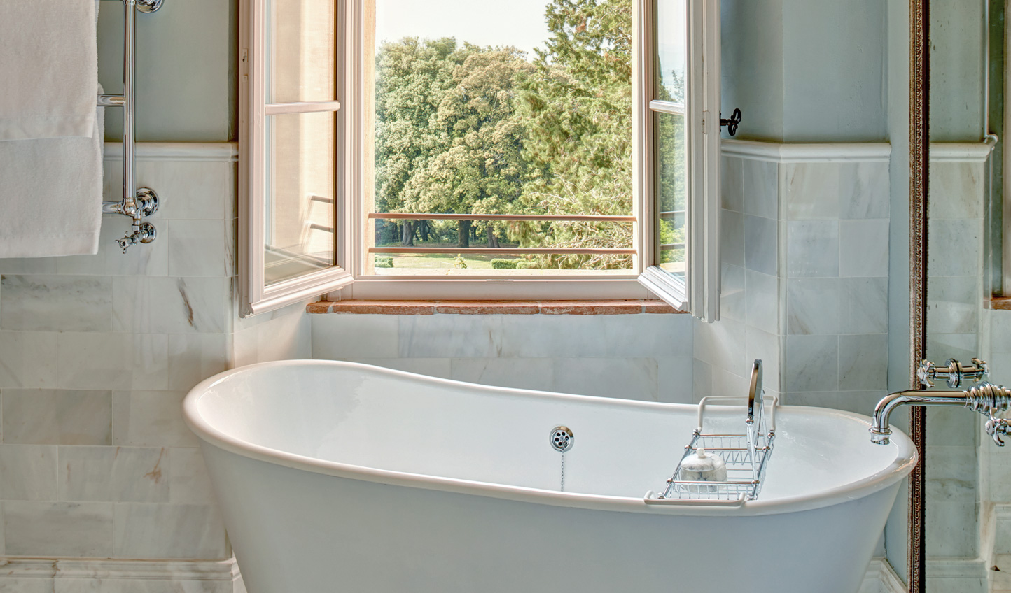 Soak in the tub with a view over the Tuscan hillsides
