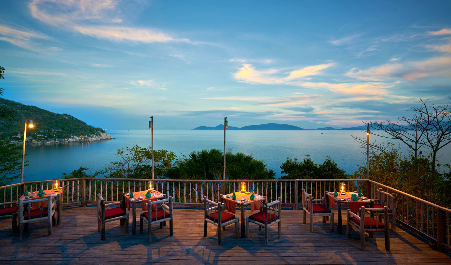 Dine on the rocks with fantastic sunset views over the bay