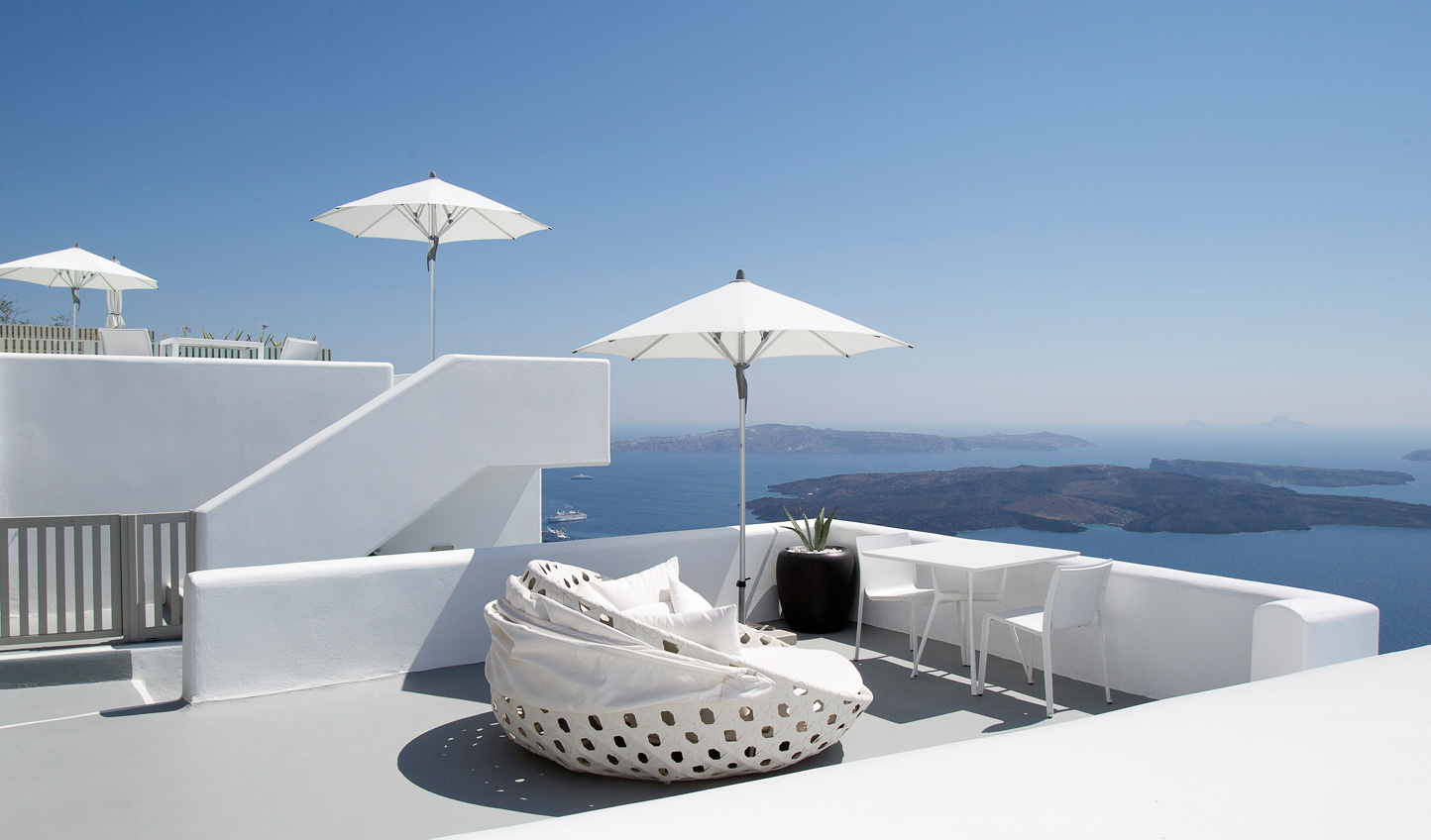 Look out over the endless hues of blue from your private terrace