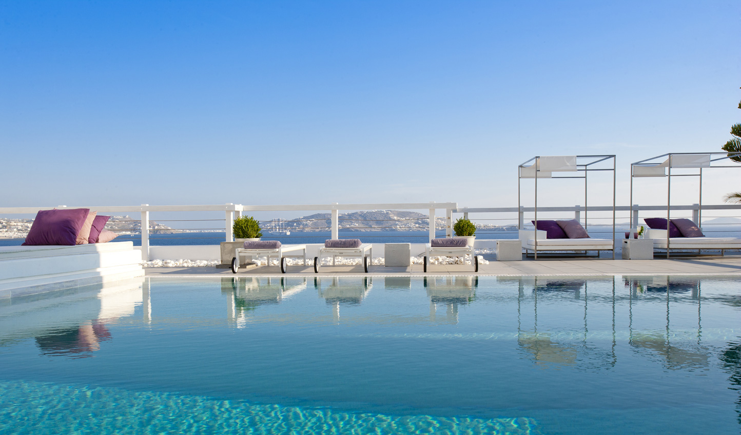 Soak up the Myconian sunshine from the poolside