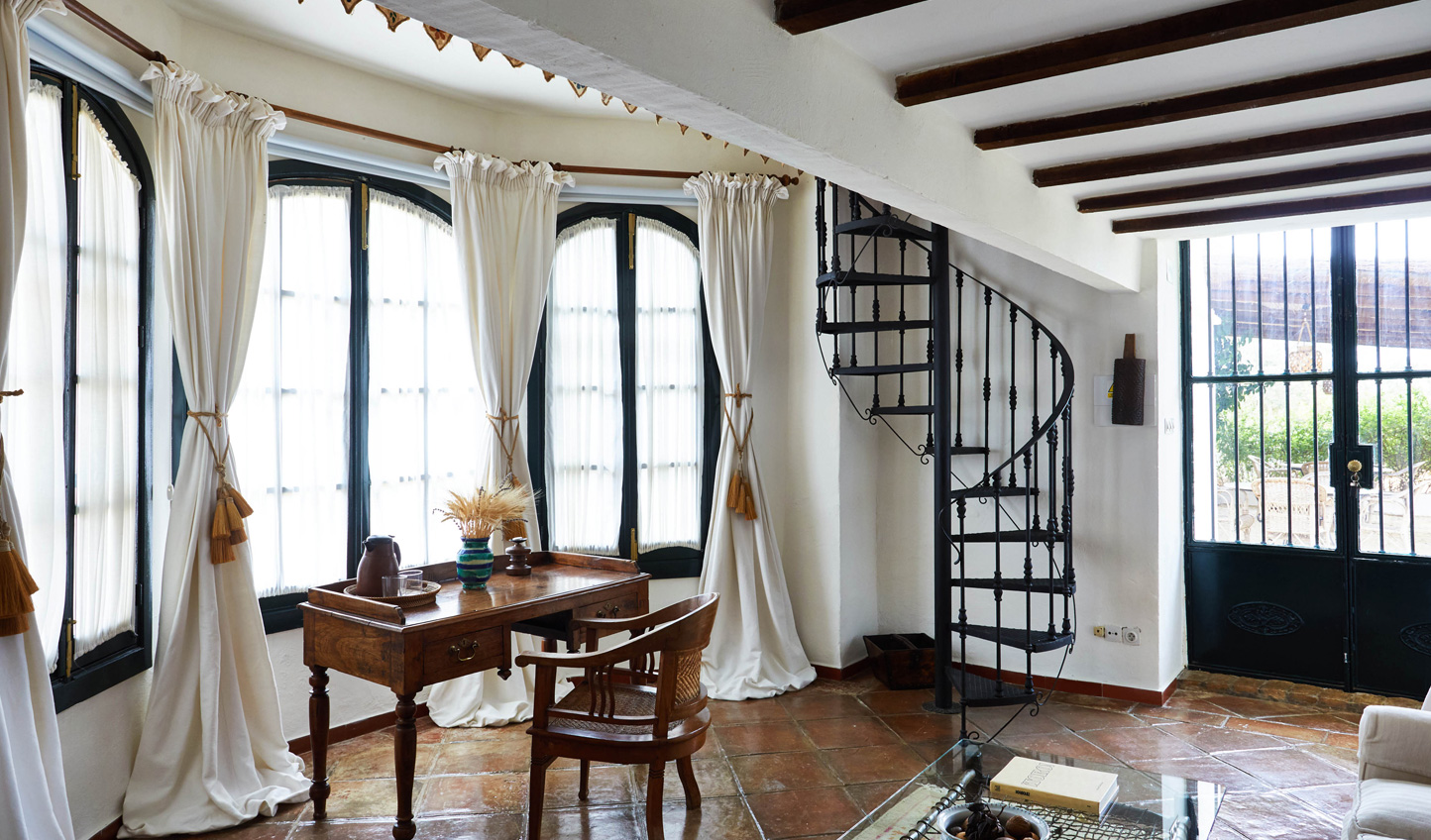 Charming duplex villas with wrought iron winding staircases