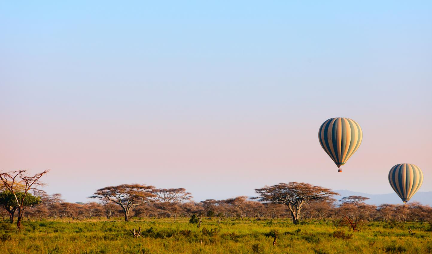 Embark on a hot air ballooning adventure over the savannah