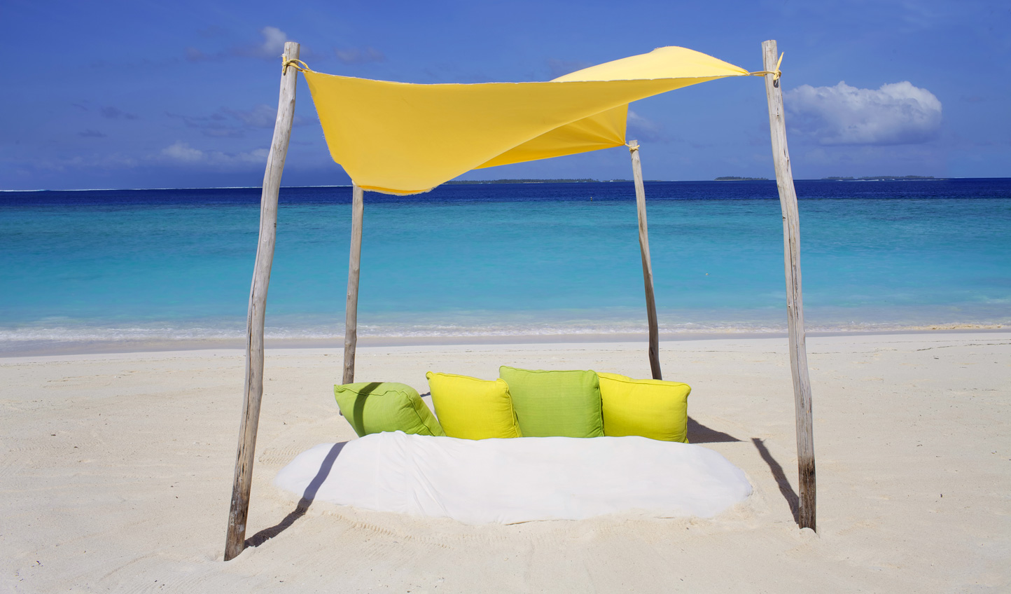 While away the hours on soft sands gazing at azure waters