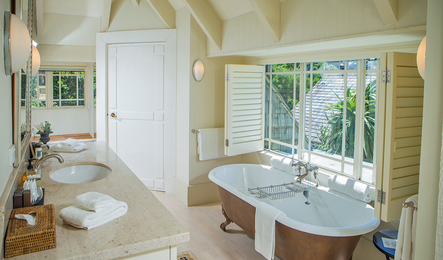 Sink into the bath tub and bask in the sunlight steaming in through the window