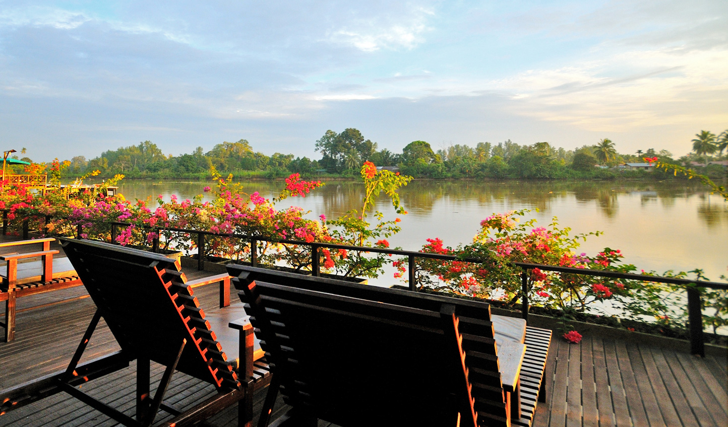Watch the sun dip down over the Kinbatangan River