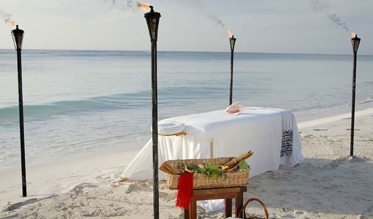 Enjoy a beachside massage at Esencia