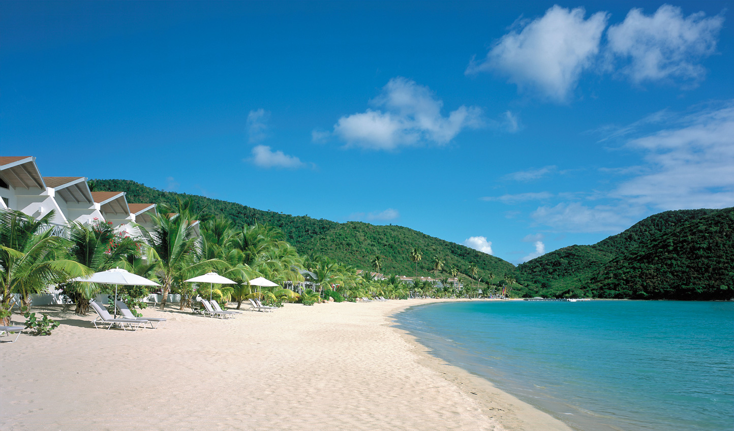 Take a stroll along the soft sands of Carlisle Bay