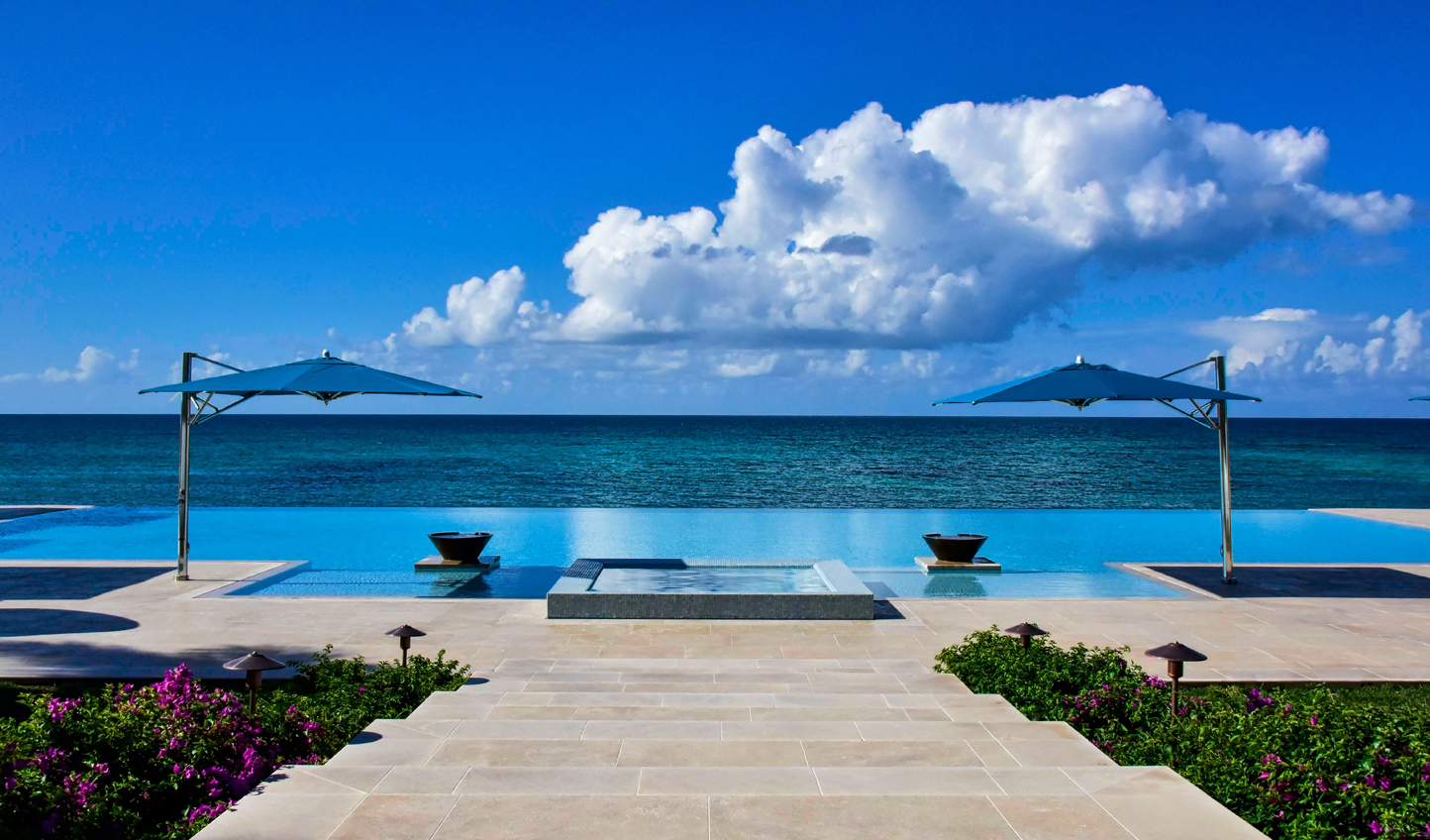Where crystal seas meet azure skies and infinity pools