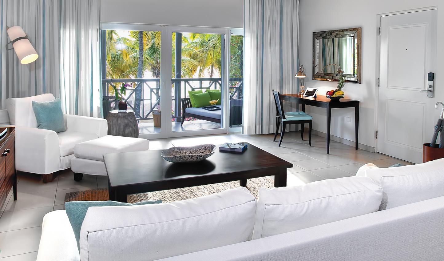 A neutral colour scheme highlights the tropical hues outside