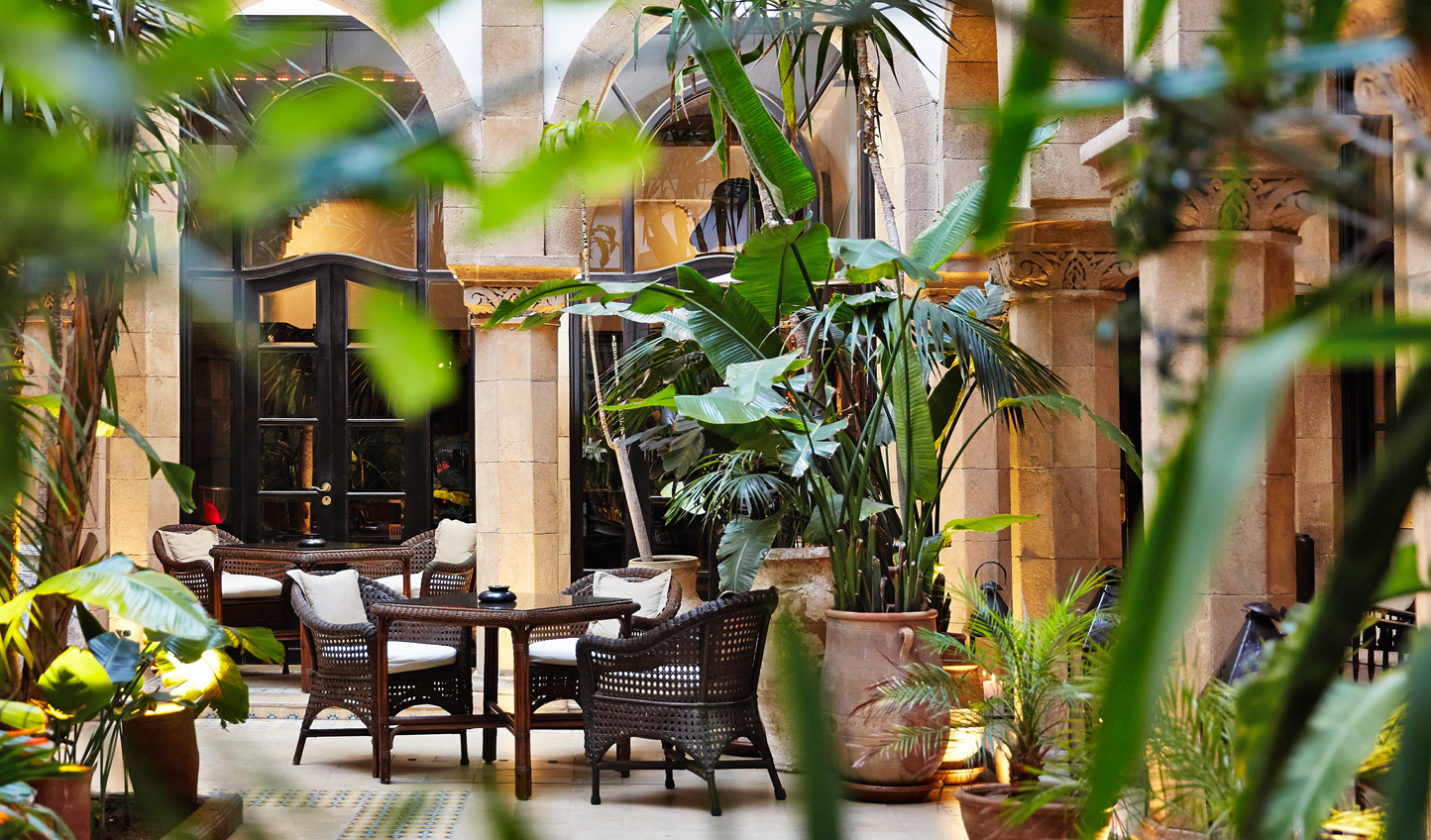 Enjoy your breakfast amid the verdant greenery of the courtyard