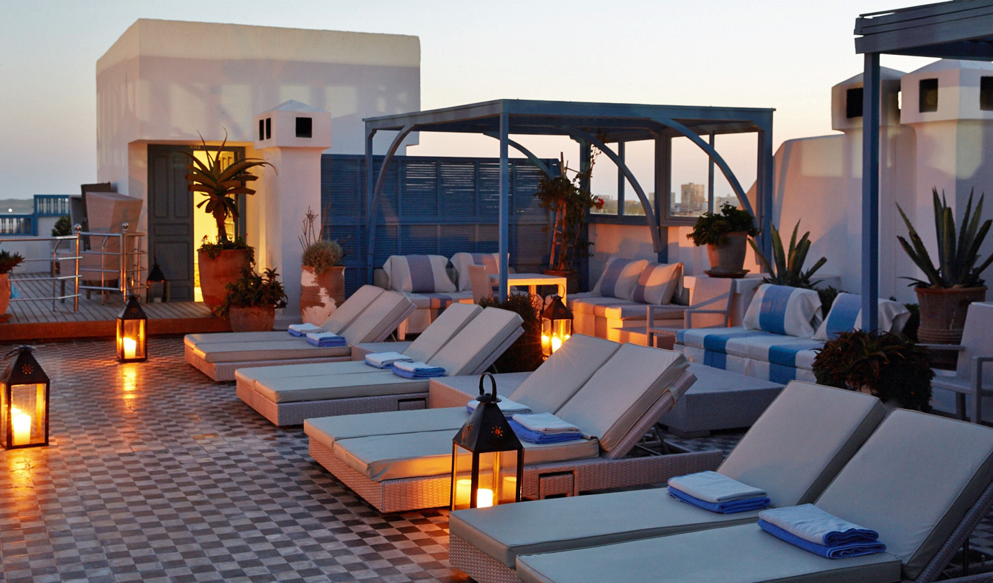 Head to the rooftop to catch the sunset dipping into the Ocean