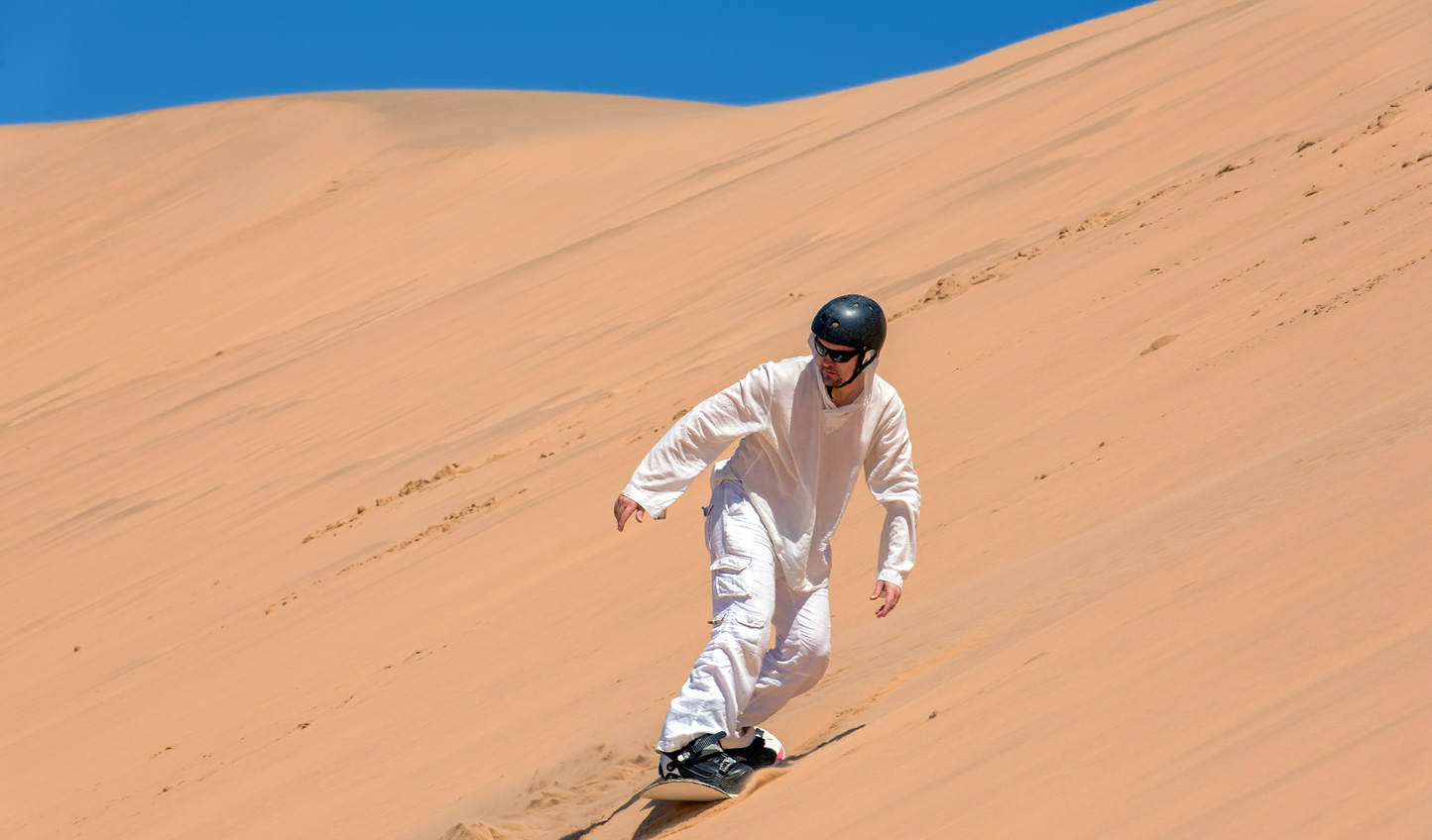 Zoom down a sand dune in style