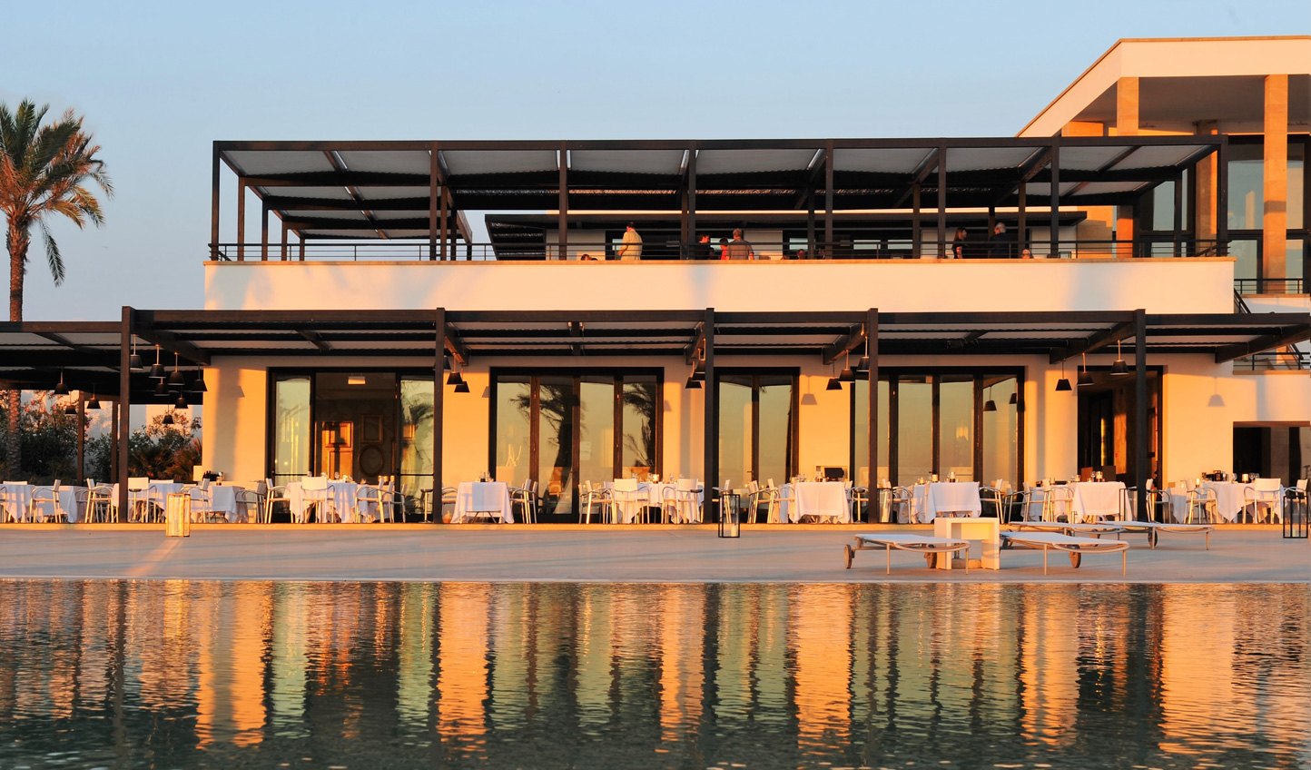 Dine poolside as dusk rolls in and bathes the land in a golden light