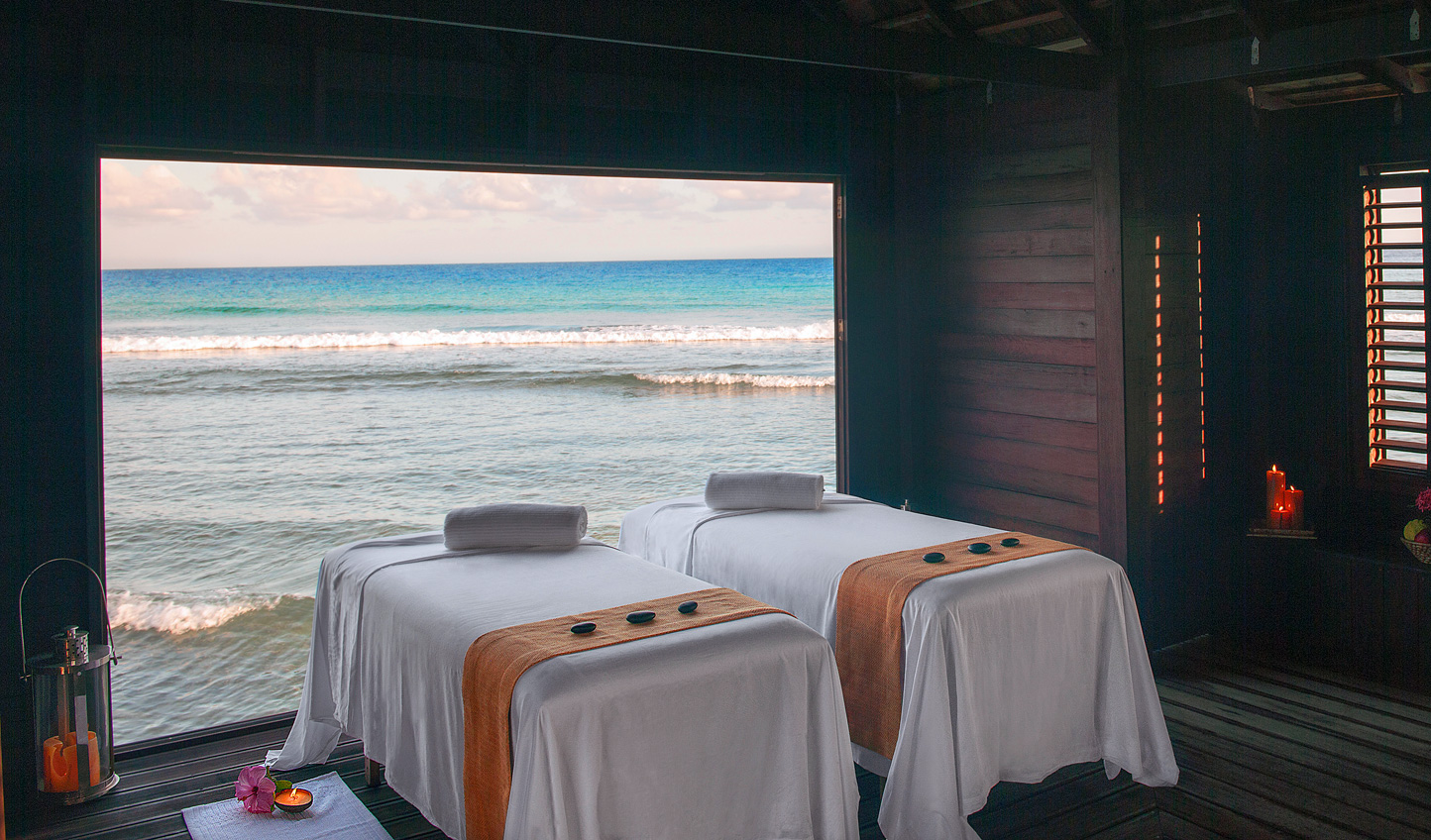 Indulge in a soothing massage with a soundtrack of lapping waves